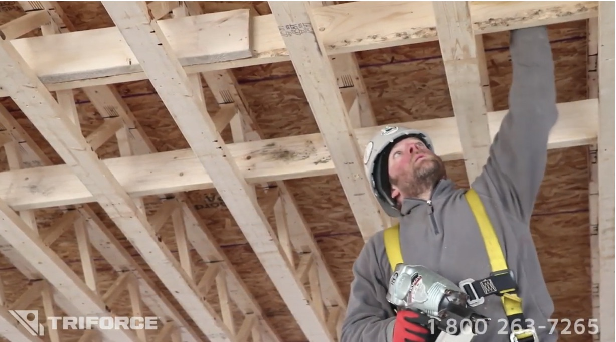 Floor system with joists installed by worker